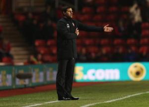 Mauricio Pochettino manager of Southampton signals from the bench during the Barclays Premier League match between Southampton and Everton